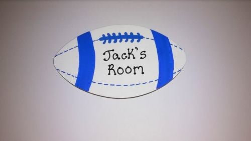 Rugby ball shaped door plaque or award
