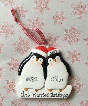 Personalised couple's first married christmas decoration - penguin