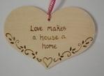 Love makes a house a home plaque