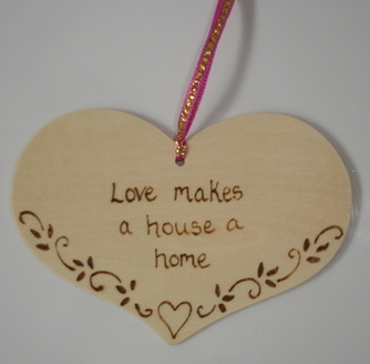 Love makes a house a home plaque
