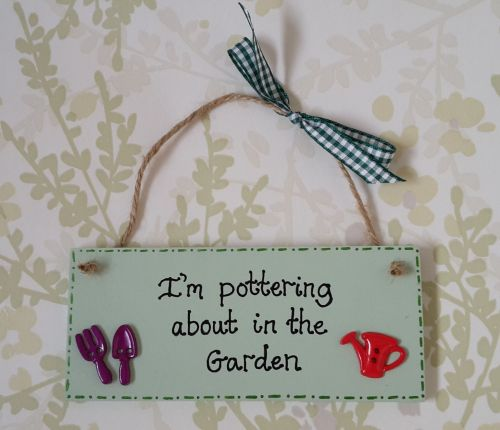 <!-- 0001 -->I'm in the garden plaque