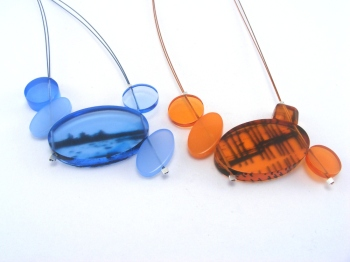 2 triple necklace coastal view