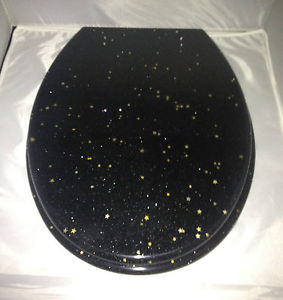 Black resin toilet seat w/ Gold Stars and Chrome finish hinge