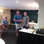 Andy Riddle presents Craig Langmead with his nearest the pin prize.