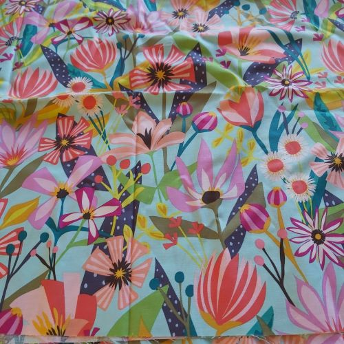 Tropical flowers on blue background - cotton fabric