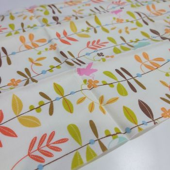 Leaves on cream cotton fabric