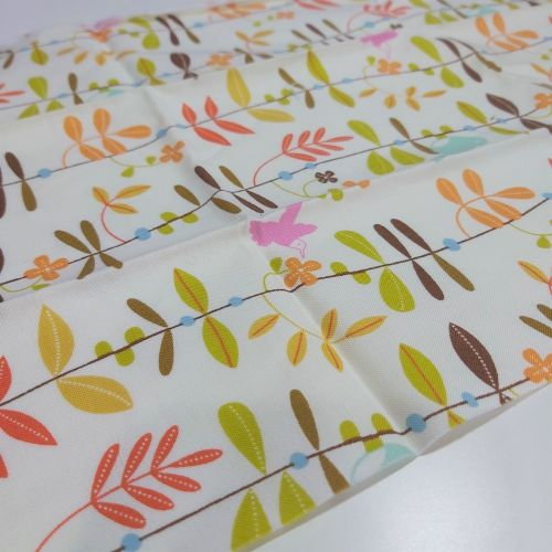 Leaves on cream cotton fabric