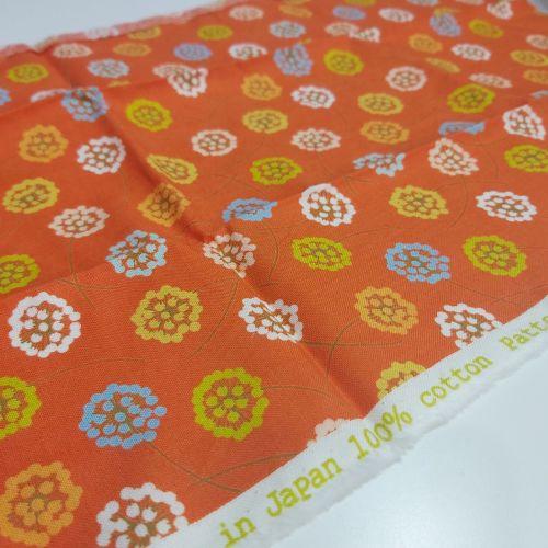 Flowers on orange cotton fabric