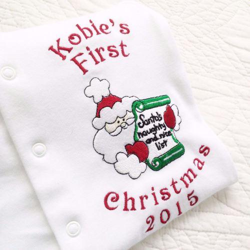 Personalised Baby's first christmas sleepsuit  Santa's list