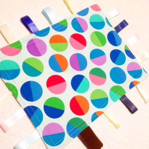 Spotty fabric baby taggy blanket