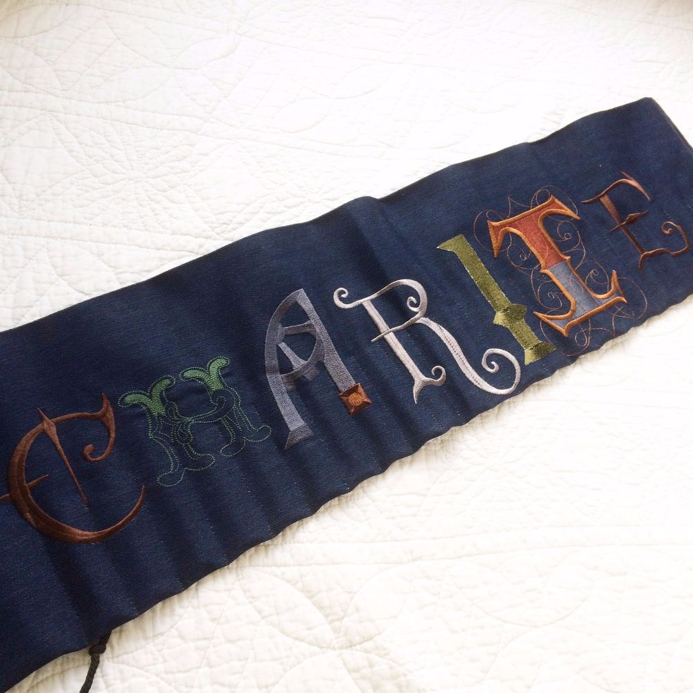 Personalised embroidered pencil roll