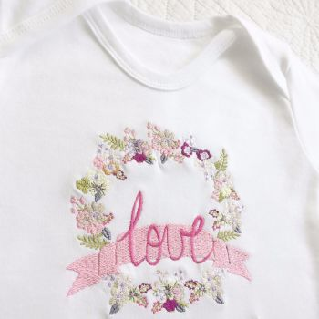 Whimsical embroidered babygrow sleepsuit