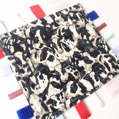 Cow print baby taggy blanket