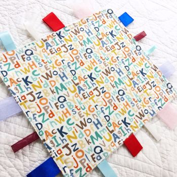 Alphabet letters baby taggy blanket