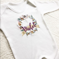 Whimsical floral wreath personalised babygrow sleepsuit by Jellibabies