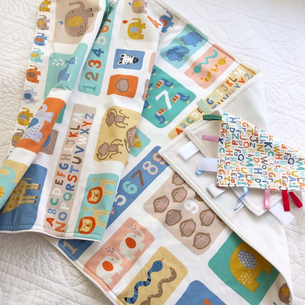 Safari Jungle animals baby cot blanket and matching taggy blanket by Jellib