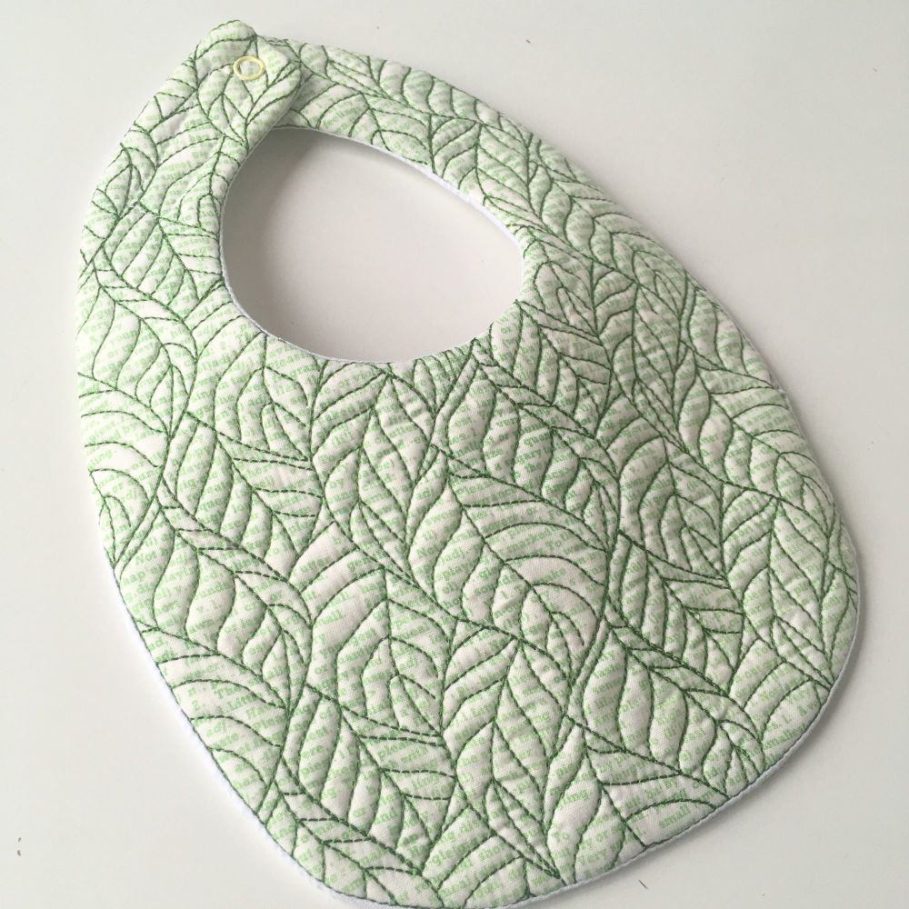 Quilted embroidered leaf design baby bib