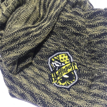 Knitted magical gold and black badger baby blanket