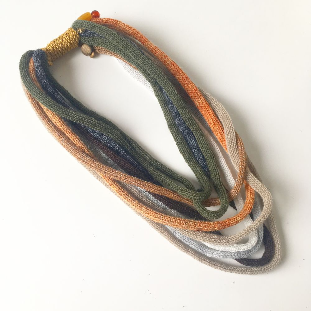 Knitted infinity scarf necklaces