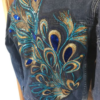 Embroidered upcycled peacock feather denim jacket by Sewincarnation on Etsy
