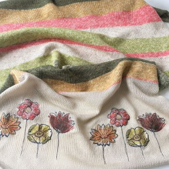 Knitted and embroidered rainbow floral blanket by Jellibabies.co.uk