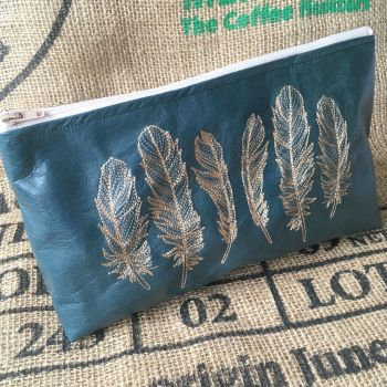 Reclaimed recycled leather embroidered feather zip bag