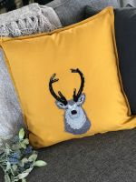 Stags head embroidered and applique cushion
