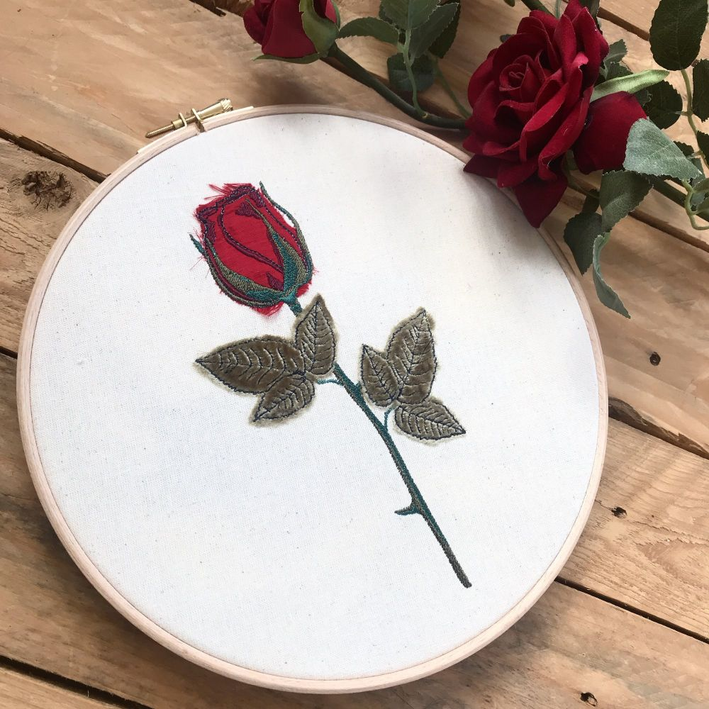 Embroidered and appliquéd rose wall art