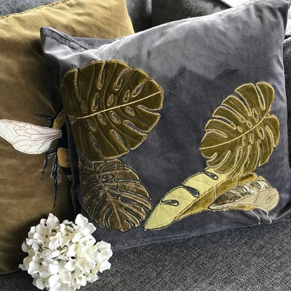 Embroidered and appliquéd tropical leaves cushion
