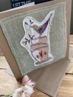 Embroidered bird and tea cups greetings card