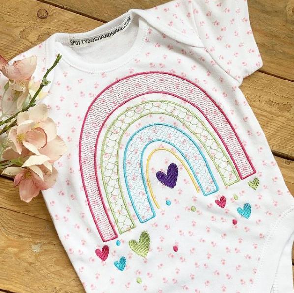 Embroidered rainbow baby onesie vest