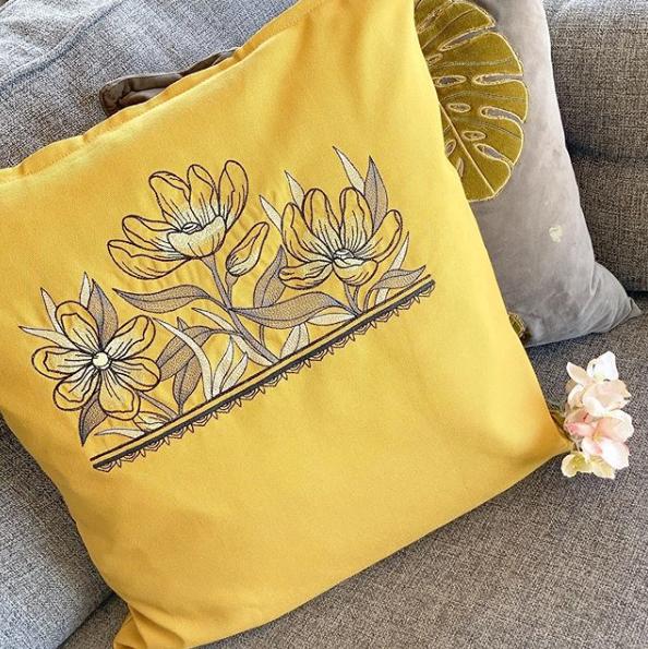 Magnolia embroidered  cushion