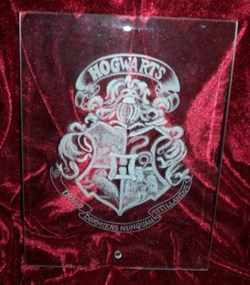 HOGWARTS SCHOOL BADGE ON GLASS PLAQUE BY ROLLDOVE STUDIO
