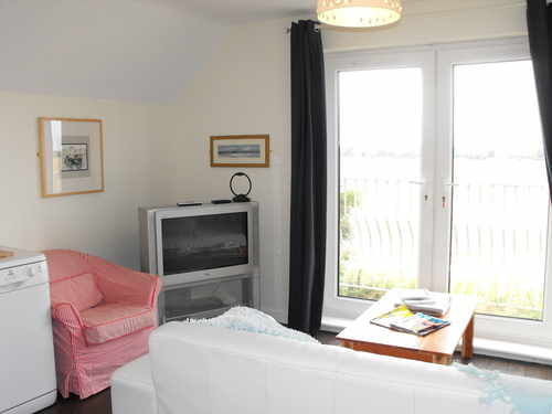 Blossom Cottage - Lounge view - including TV and patio doors