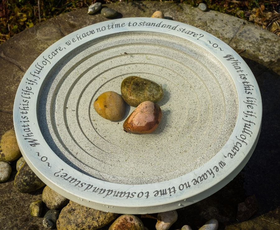 This bird bath is made from a mix of recycled plastics and clay
