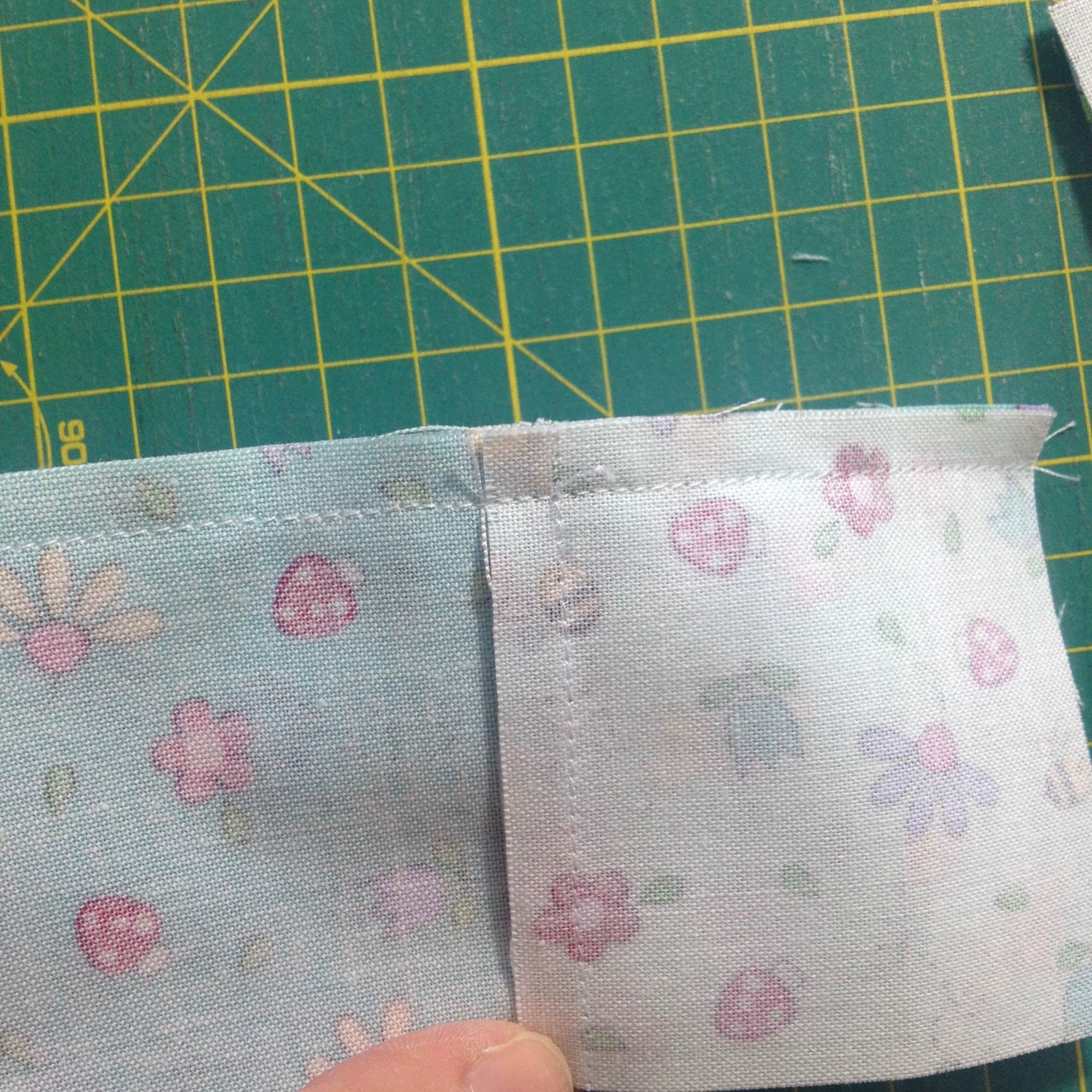 Flattening a seam in a four-patch