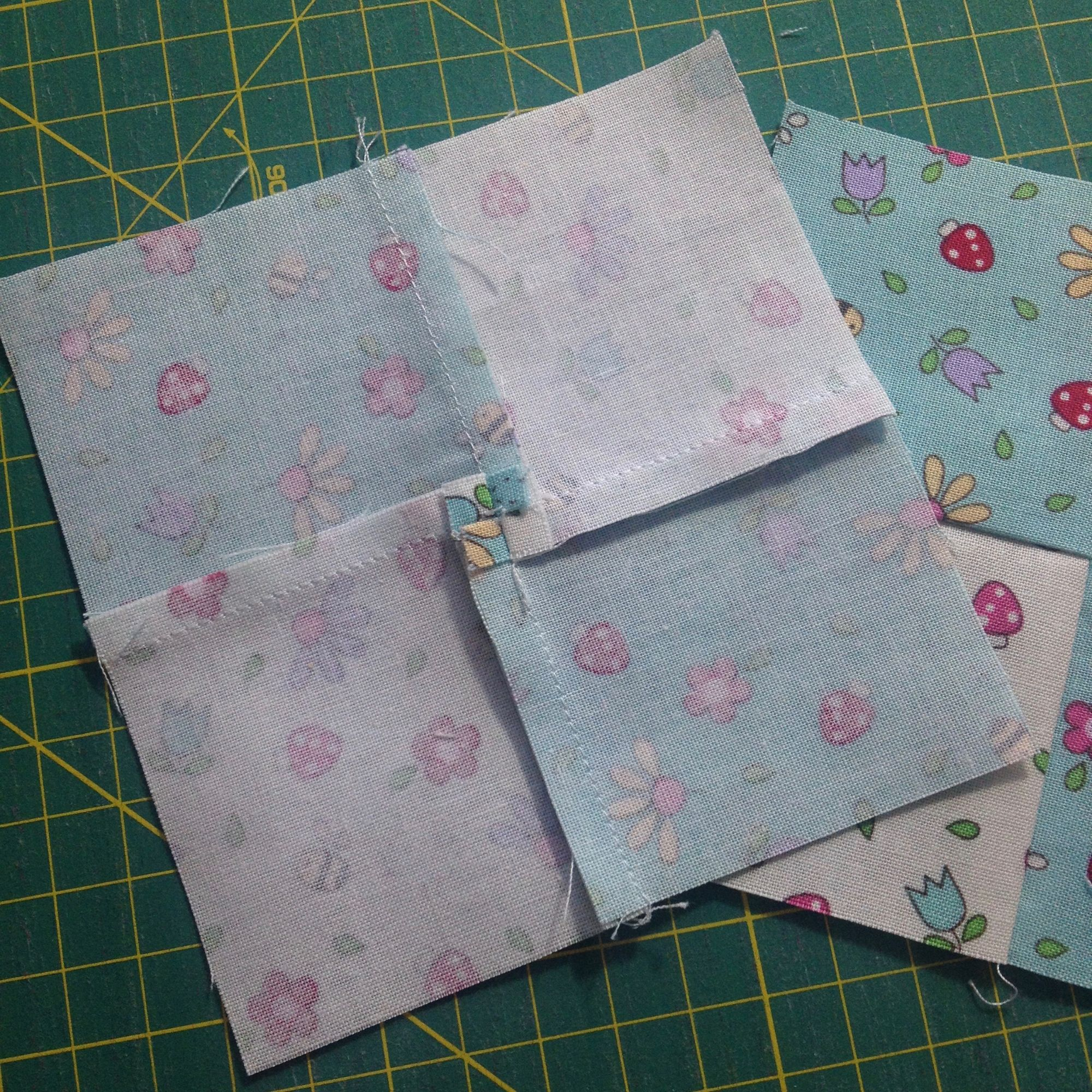 Complete four-patch with charm squares