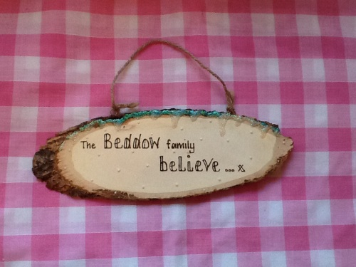 this house believes personalised wooden sign plaque
