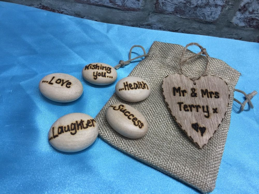 Wooden wish pebbled in a hessian bag