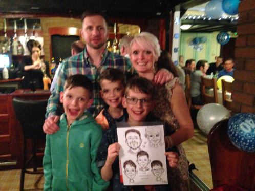 My lovely family and our caricature