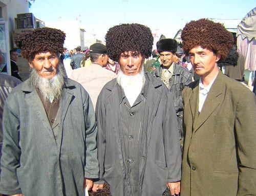Three Turkmen fellows in traditional hats