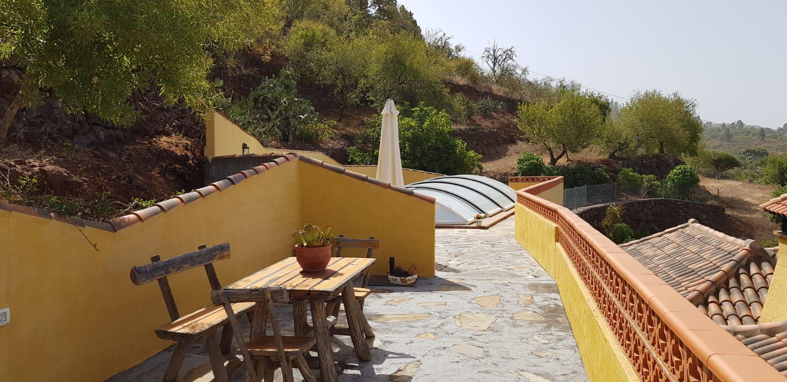 Patio area by the pool Villa Alicia