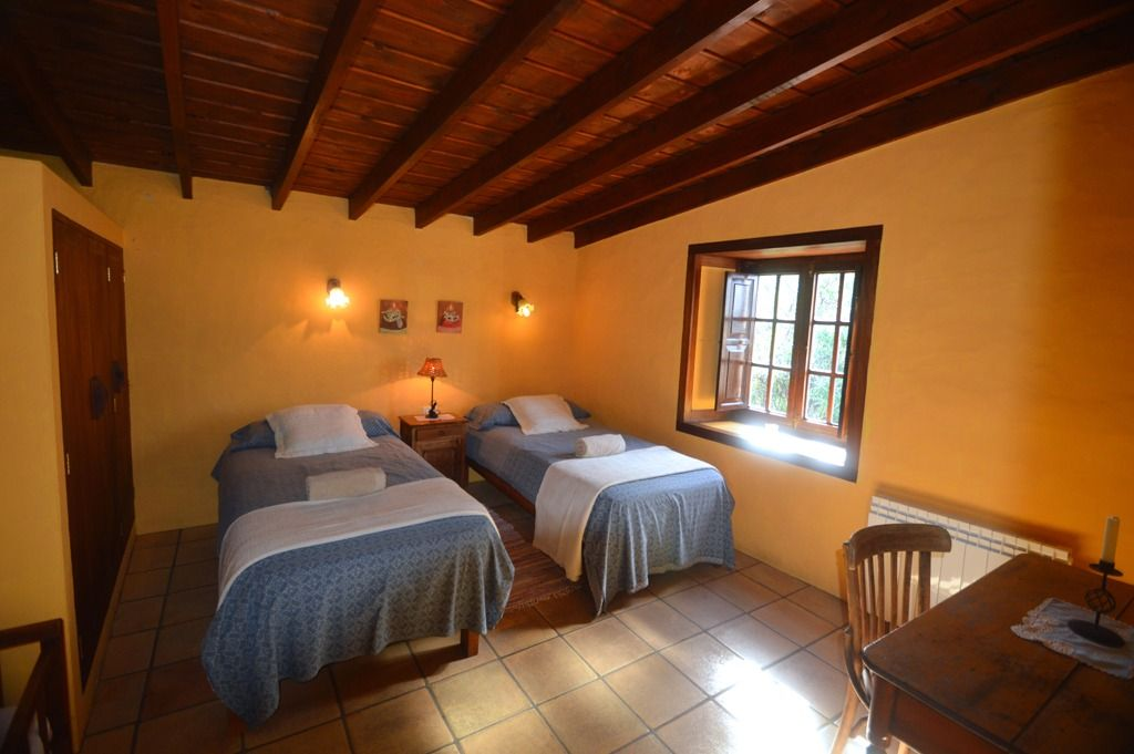 The twin bedroom is spacious and with great views to the garden