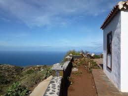 Casa Noral side view with sea