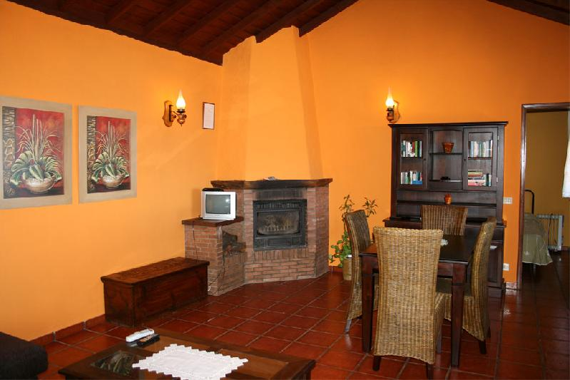 Casa La Verada dining area with log fire