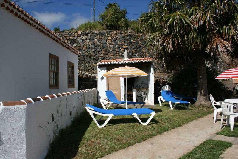 Casa Peluquina lawned area