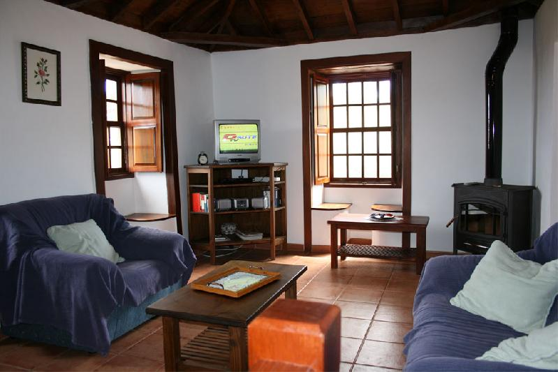 Casa Las Embelgas lounge with log stove