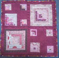 Square patchwork quilt in maroon and pinks (P1020580)