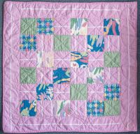 Square patchwork quilt in  pinks with contrasting colours P1020823