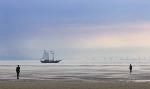 Sailing ship passing the wind turbines and Antony Gormleys Iron Men (4941)